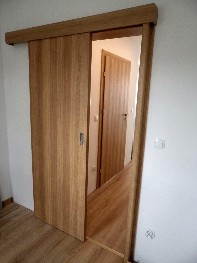 Drzwi wewnętrzne płytowe w systemie przesuwnym naściennym - FHU Tokarczyk