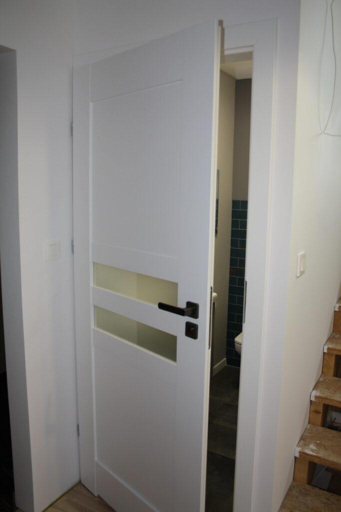 Białe drzwi Monaco z przeszkleniem mlecznym - FHU Tokarczyk Kraków